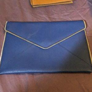 Envelope clutch with zipper detail, minor smudges